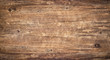 Wood texture background. Surface of old knotted wood with nature color, texture and pattern. Top view of weathered vintage wooden table with cracks. Brown rustic rough wood for backdrop.