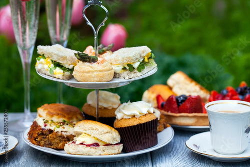 Fotografie, Obraz  Afternoon tea with sandwiches and cakes