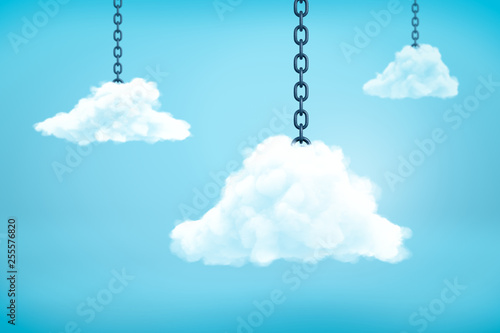 Fotografering  3d rendering of three white fluffy clouds hanging on metal chains in the blue sky