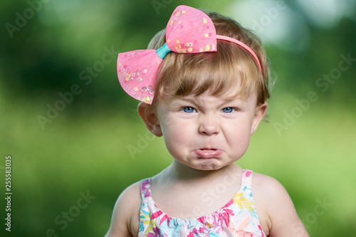 Fotografie, Tablou  Portrait of a angry little girl with blue eyes