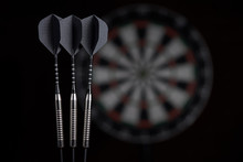 3 Darts On Dartboard Backgroun...