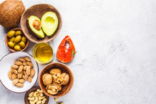 Healthy Fat Food Background. Fish, Nuts, Oil, Olives, Avocado On White Background, Top View
