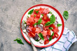 canvas print picture - Watermelon salad with tomato, feta cheese, red onion and basil on a plate.Top view with copy space.