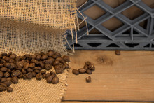 Coffee Beans On Burlap With A Milk Crate In The Background