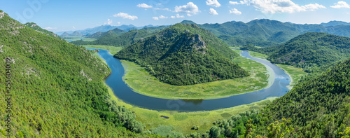 Canvas Prints Forest river The picturesque meandering river flows among green mountains.