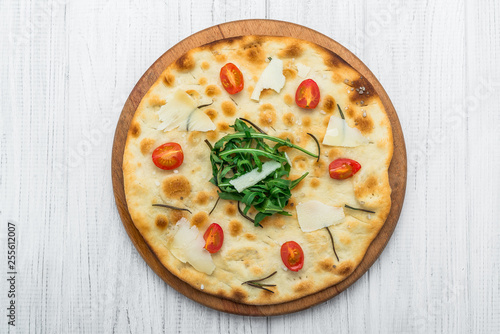 Fotografiet  Traditional Italian Focaccia with tomatoes, black olives and rosemary - homemade