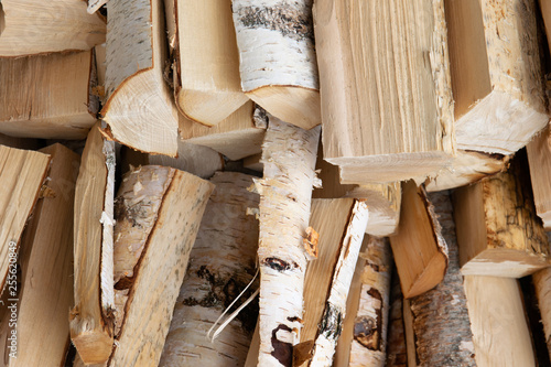 Fotoposter Brandhout textuur pile of wooden logs, stack of chopped birch firewood