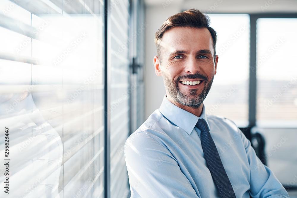 Fototapeta Portrait of successful businessman in modern office