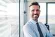 Portrait of successful businessman in modern office