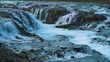 Scenic Midfoss waterfalls Iceland. Spring blue water. 4K resolution.