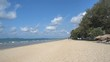 Wide view of a deserted idyllic sandy beach with nobody around.
