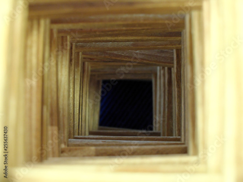 Fotografie, Obraz  The wooden tunnel to the dark abyss