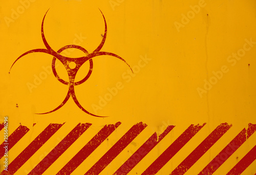 Leinwand Poster Red biohazard sign over yellow background