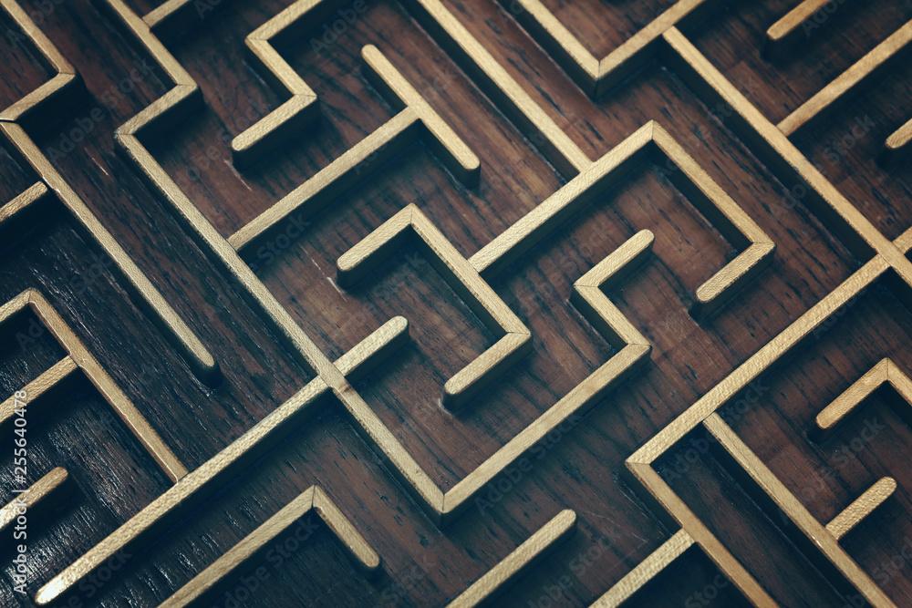 Fototapeta Wooden brown labyrinth maze puzzle close up