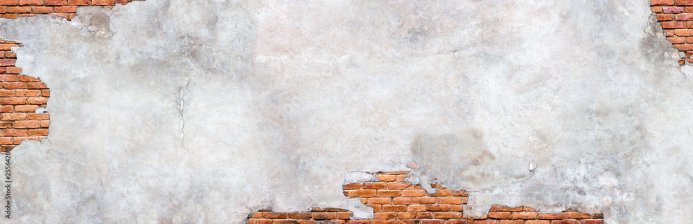 Fototapeta Damaged plaster on brick wall background. Brickwork under crumbling texture  concrete surface