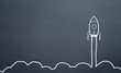 canvas print picture - chalk drawing rocket on blackboard Going up quickly