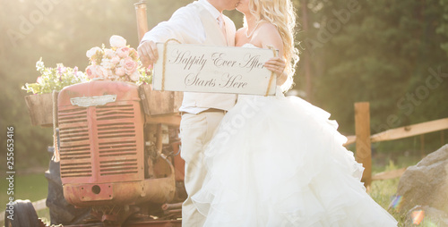 Fotografie, Tablou  Country wedding couple holding Happily ever after sign