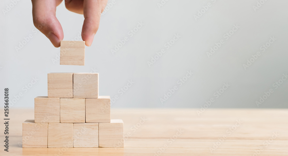 Fototapety, obrazy: Hand arranging wood block stacking as step stair. Business concept for growth success process