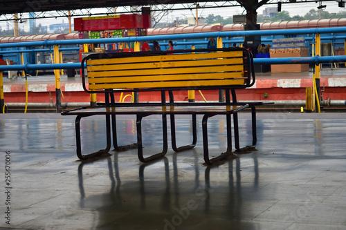 Foto  wooden bench at railway platform