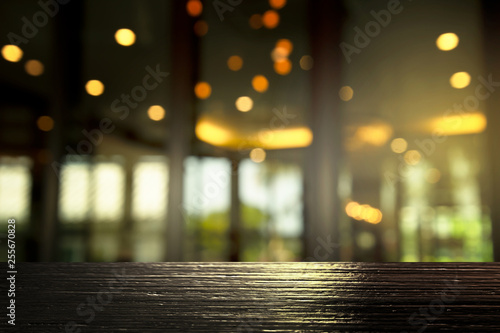 Fototapety, obrazy: top of black wood with blur light in cozy bar party in the dark night background