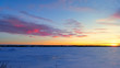 canvas print picture Beautiful Sunset and Pink clouds over frozen lake