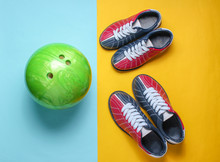 Bowling Shoes And Bowling Ball On Blue Yellow Background. Indoor Family Sports. Top View. Minimalism