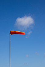 Airfield Windsock, Used To Indicate Wind Speed And Direction, Shown Fully Extended In High Winds
