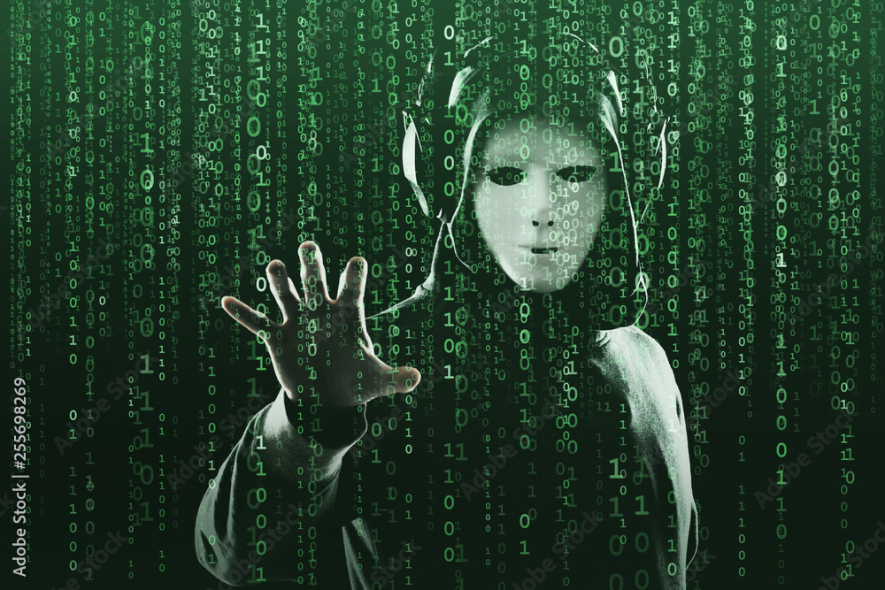 Fototapeta Anonymous computer hacker over abstract digital background. Obscured dark face in mask and hood. Data thief, internet attack, darknet fraud, dangerous viruses and cyber security.