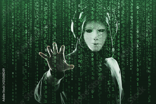 Photo Anonymous computer hacker over abstract digital background
