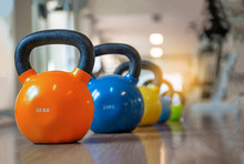 Colorful Kettlebells In A Row In A Gym, Orange, Yellow, Blue, Green - Image