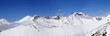Leinwanddruck Bild - Panorama of mountains with snowy off-piste slope and blue sunlit sky at winter