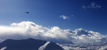 Panoramic View On Helicopter And Snowy Plateau In Winter