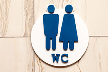 Toilet, Wc Icon, Round Wooden White And Brown Sign On Restroom Door In The Hallway, Restaurant, Lobby. Concept Sign Of Toilet Room At Airport, Cafe, Bar, Hotel, Train Station