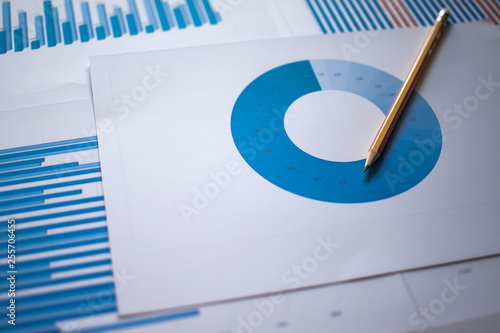 Photo  Many charts and graphs with magnifying glass and many pencil