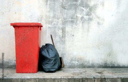 closeup red trash bin with soft-focus and overlight in the background Canvas Print