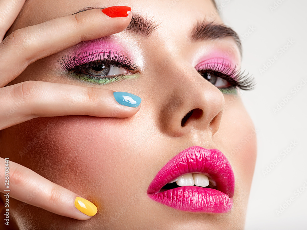Fototapety, obrazy: Beautiful fashion woman with a colored nails. Attractive white girl with multicolor manicure.