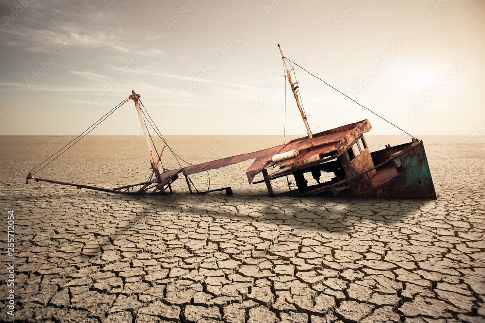 Fototapeta Rusty ship in a dried ocean. Concept of global warming and climate change