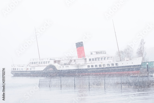Fototapeta Steam ship in winter at Loch Lomond snowing maid