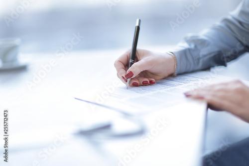 Fototapeta close up.business woman signing a lucrative contract obraz
