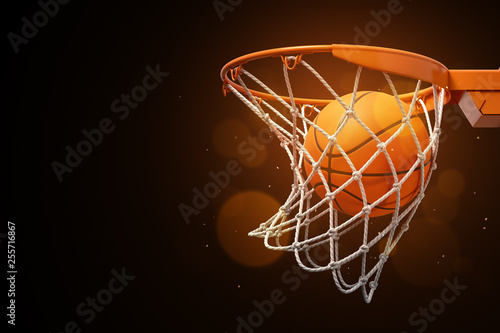 Fotografia 3d rendering of a basketball in the net on a dark background.