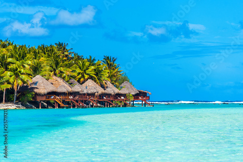 Foto auf AluDibond Licht blau Stunning tropical Aitutaki island with palm trees, water bungalow, white sand, turquoise ocean water and blue sky at Cook Islands, South Pacific. Copy space for text.