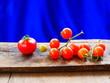 Leinwanddruck Bild - organic tomato in a bowl on wooden table