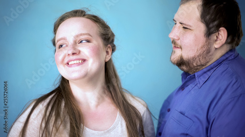 Fotografía  Overweight male making compliment girlfriend, feeling happiness, good emotions