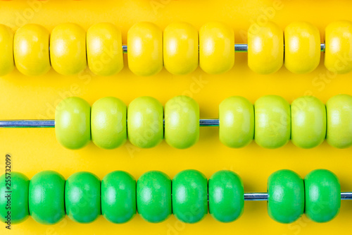 Colorful wooden abacus beads on vivid yellow background, business financial or a Canvas-taulu