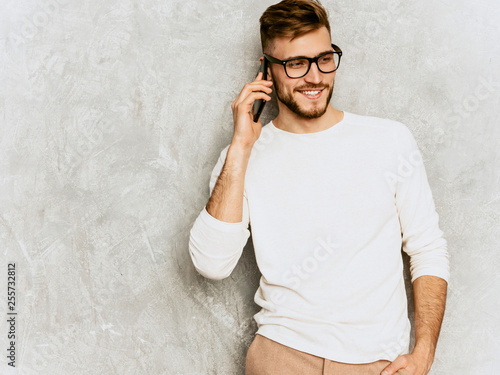 Fotografia  Portrait of handsome smiling hipster lumbersexual businessman model wearing casual summer white clothes