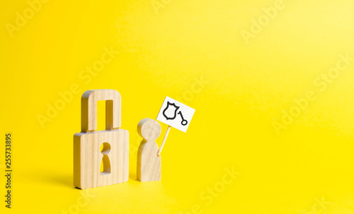 A wooden padlock and a person with a poster is trying to authenticate or bypass the protection Canvas Print