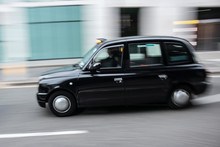 Black Cab Taxi  In Motion On T...