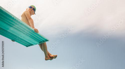 Fototapeta Boy on diving platform obraz