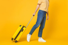 Travel And Tourism Concept. Young Woman Wearing Casual Clothes Walking With Suitcase Isolated On Yellow Background