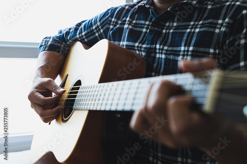 Fotografie, Obraz  Close up men wearing blue plaid shirts playing guitar